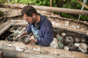Removing the wood-fired stoneware