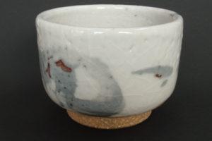 Feldspar shino glaze on coarse kaolin clay, ochre underglaze brush decoration