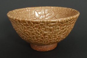 Snakeskin glaze on ferrous clay