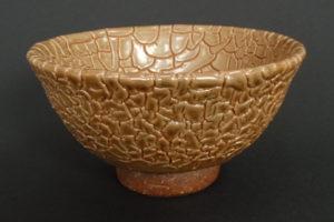 Snakeskin glaze on ferrous clay