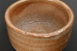 Red shino on porous fragment